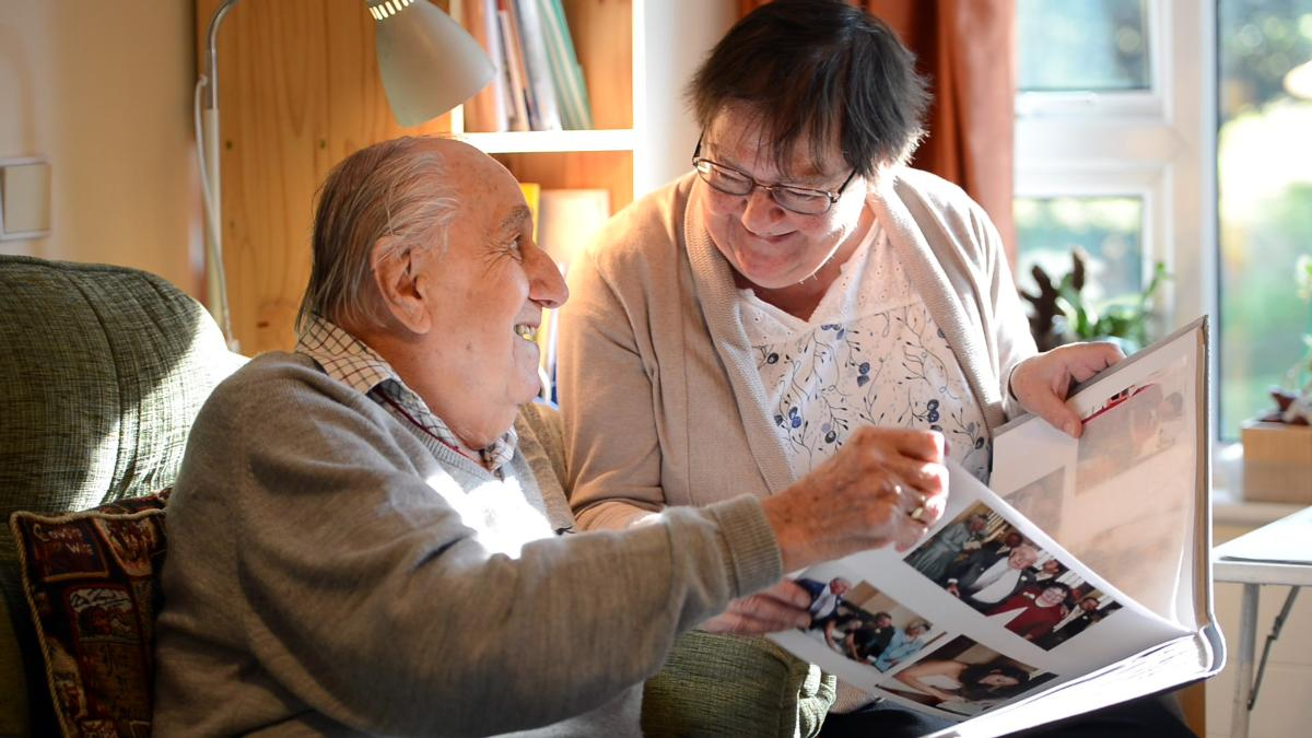 residents looking through photos with daughter