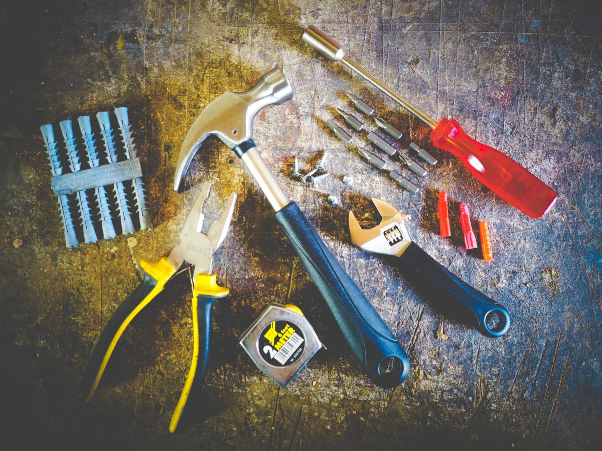 a collection of tools including hammer, screwdriver and screws