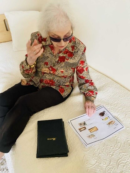 Lady resident with paper menus printed in a pile